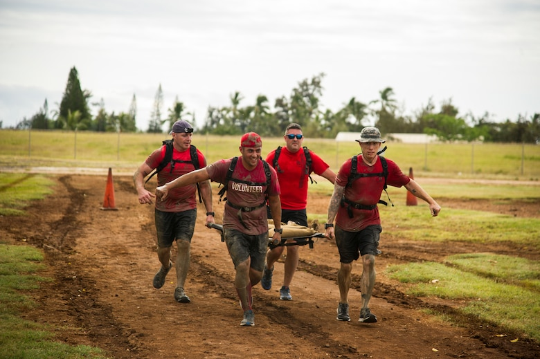 Participants compete against one another during the Inaugural Diamond Mudder, Joint Base Pearl Harbor-Hickam, Hawaii, May 4, 2018.  The Diamond Mudder was a seven-mile team race, consisting of eight obstacles ranging from buddy drags to marksmanship. (U.S. Air Force photo by Tech. Sgt. Heather Redman)
