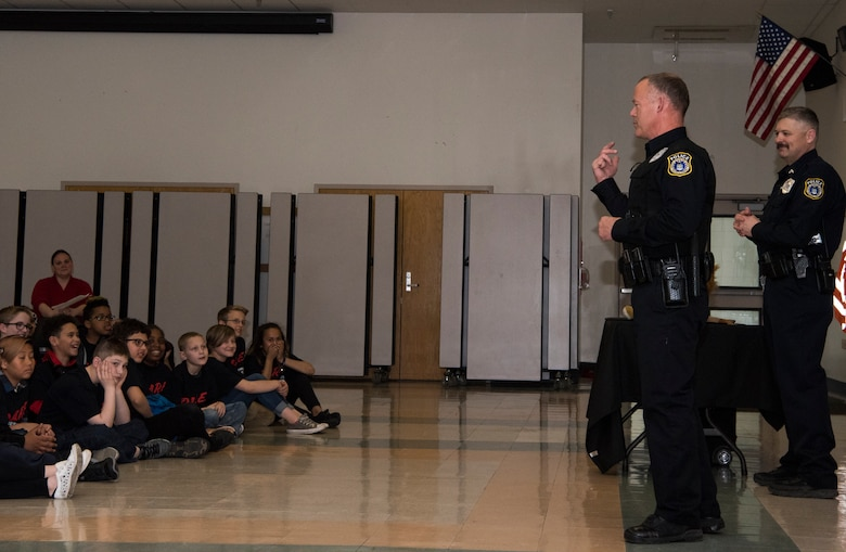 Police officers from the 673d Security Forces Squadron speak with students from the Drug Abuse Resistance Education program at Ursa Major Elementary School at Joint Base Elmendorf-Richardson, Alaska, May 2, 2018. D.A.R.E. is a program designed to provide students with the knowledge and tools they need to resist drugs, alcohol and other high-risk behaviors.