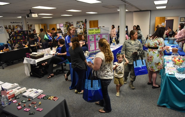 Military spouses attend Pamper Me Day in the Sablich Center at Keesler Air Force Base, Mississippi, May 3, 2018. The 81st Force Support Squadron Airman & Family Readiness Center has hosted the event for the past 14 years, offering military spouses information and business booths, free manicures, makeup tips and giveaways. (U.S. Air Force photo by Kemberly Groue)