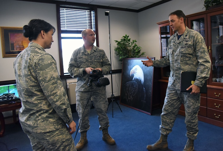 U.S. Air Force Lt. Col. Stephen Arnott, 81st Training Support Squadron commander, and Staff Sgt. Chris Wilson, 81st TRSS instructional developer, explain the benefits of using virtual reality for training purposes to Col. Debra Lovette, 81st Training Wing commander,  in the 81st TRW headquarters building at Keesler Air Force Base, Mississippi, May 4, 2018. The 81st Training Group has implemented augmented and virtual reality into training, such as airfield, weather and air traffic control training. (U.S. Air Force photo by Kemberly Groue)