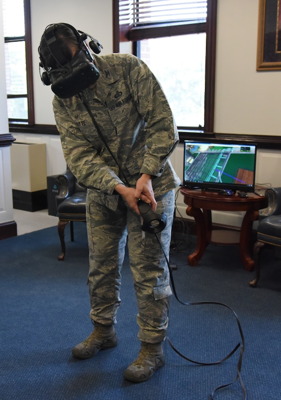 U.S. Air Force Col. Debra Lovette, 81st Training Wing commander, participates in a virtual reality demonstration in the 81st TRW headquarters building at Keesler Air Force Base, Mississippi, May 4, 2018. The 81st Training Group has implemented augmented and virtual reality into training, such as airfield, weather and air traffic control training. (U.S. Air Force photo by Kemberly Groue)