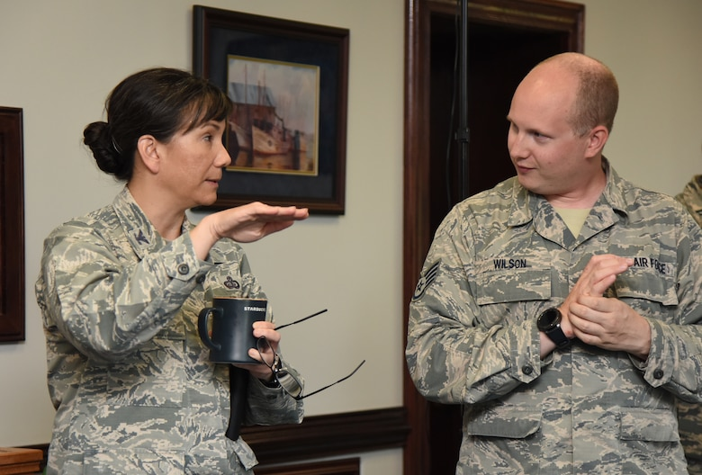 U.S. Air Force Col. Debra Lovette, 81st Training Wing commander, discusses the benefits of using virtual reality for training purposes with Staff Sgt. Chris Wilson, 81st Training Support Squadron instructional developer, in the 81st TRW headquarters building at Keesler Air Force Base, Mississippi, May 4, 2018. The 81st Training Group has implemented augmented and virtual reality into training, such as airfield, weather and air traffic control training. (U.S. Air Force photo by Kemberly Groue)