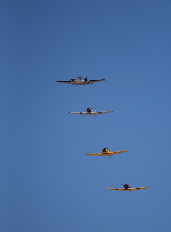Four heritage aircraft fly over Holloman Air Force Base during the 2018 Legacy of Liberty open house in N.M., May 5, 2018. Holloman opened its gates to the public to show some of the capabilities of the U.S. Air Force, including an F-16 Fighting Falcon demonstration team, several static displays and a show from the Air Force Academy's Wings of Blue Team. (U.S. Air Force photo by Staff Sgt. Timothy Young)