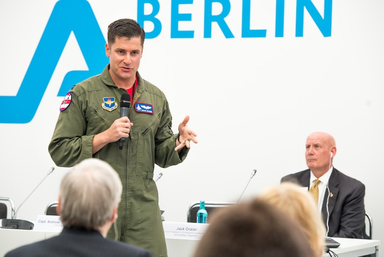 "Capt. Andrew ""Dojo"" Olson, F-35 Heritage Flight Team commander and pilot, speaks to the media during a press conference at the 2018 Berlin Air and Trade Show at the Berlin Schönefeld Airport in Berlin, April 26, 2018. The press conference allowed Olson to share his personal experiences in flying the Air Force's most advanced fighter jet as well as answer questions from various members of the media"