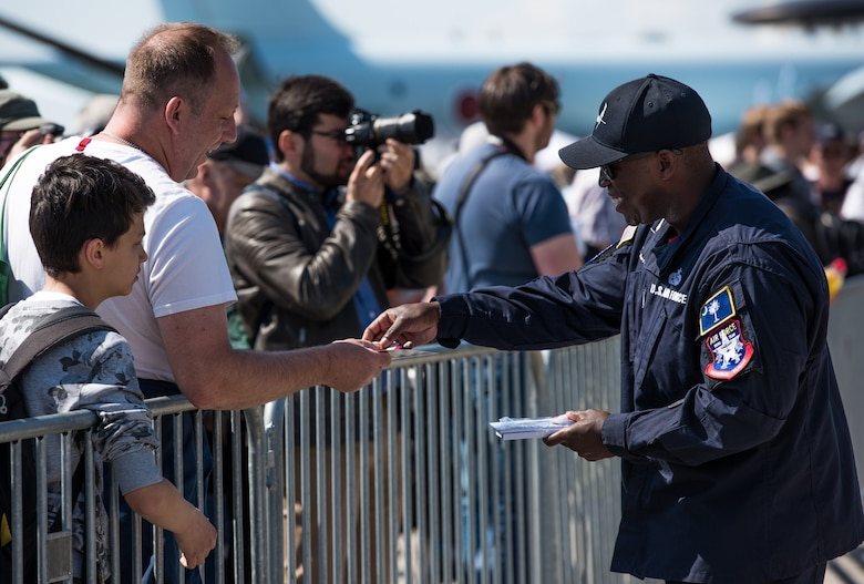 Staff Sgt. Ivan Sumter, F-35 Heritage Flight Team crew chief, interacts with air show guests during the 2018 Berlin Air and Trade show at the Berlin Schönefeld Airport in Berlin, April 28, 2018. The show provides a collaborative opportunity to share and strengthen the U.S. and European strategic partnership that has been forged during the last seven decades and is built on a foundation of shared values, experiences and vision.