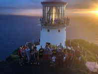 The Honolulu District U.S. Army Corps of Engineers Commander, Lt. Col. James D. Hoyman and Deputy Commander Maj. Thomas E. Piazze led about 50 Corps staff and family members for the sunrise hike April 6, 2018 celebrating the Districts 113th Birthday. The significance of Makapu'u Lighthouse for the Districts Birthday dates back to 1905 when the Corp's began their mission in Hawaii and the Pacific. The Districts first commander Lt. Col. John Slattery was charged by Congress to constructions lighthouses for navigation and draw up plans for Makapu'u Lighthouse. In August 1906 Slattery designed a short tower keeping the light as low as possible but high enough the wind couldn't blow pebbles into the lantern room glass. This first-ever 12-ton lens produced a fixed white light while a set of copper panels revolving on a track between the light source and lens produced a distinct flash.