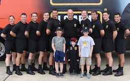 The Gold Demonstration Team, part of the Strategic Army Corps Sport Parachute Team, pose for a photo during the Power in the Pines Open House and Airshow on Joint Base McGuire-Dix-Lakehurst, N.J., May 5, 2018. The Army Golden Knights performed two times during each day of the airshow. The first performance was a mass exit and the second was a full performance. (U.S. Air Force photo by Airman Ariel Owings)