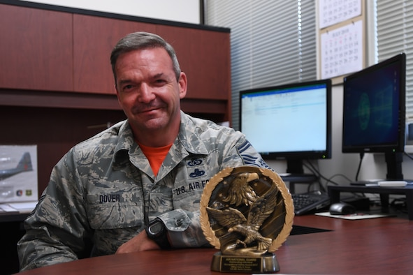 U.S. Air Force Senior Master Sgt. Kelly Dover, 145th Airlift Wing Occupational Safety Manager, poses with his Safety Award at the North Carolina Air National Guard Base, Charlotte Douglas International Airport, May 5, 2018. The 2017 Air National Guard Safety Award is rewarded annualy to seven individuals within the Air National Guard.