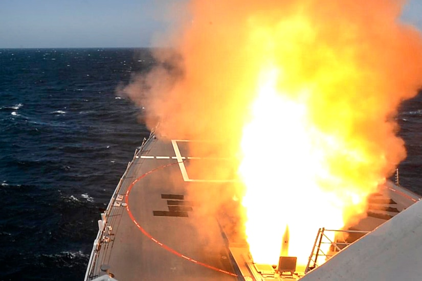 A missile launches from the guided-missile destroyer USS Spruance.