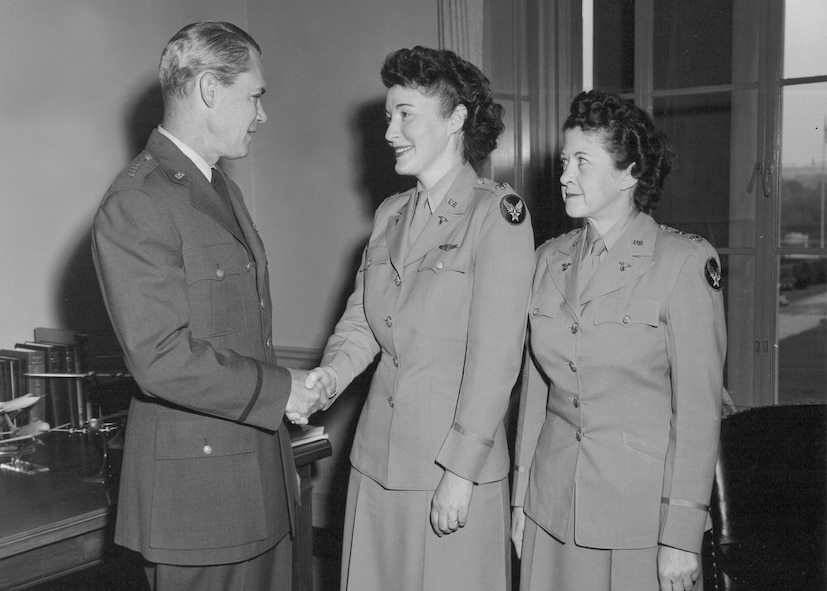 General Hoyt S. Vandenberg, Chief of Staff, U.S. Air Force, congratulates chief of the Air Force Nurse Corps, Lt. Col. Verena Zeller (center), and chief of the Air Force Women's Medical Specialists, Lt. Col. Miriam Perry (right), upon their promotion. (Courtesy photo)