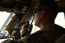 Tech. Sgt. Cameron Leek, 407th Expeditionary Security Forces Squadron truck commander, uses a handheld radio.