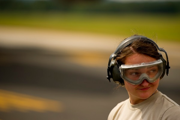 Senior Airman Michelle Reidel, an Air Transportation specialist assigned to the 30th Aerial Port Squadron, Air Reserve Station, Niagara Falls, N.Y., wears her hearing and eye protection on the flight line before an aircraft unloading during Exercise Global Medic, Fort McCoy, Wis., July 20, 2013.