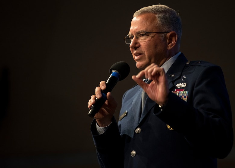 U.S. Air Force Chaplain (Brig. Gen.) Steven Schaick, deputy chief of chaplains, Headquarters U. S. Air Force, Pentagon, Washington, D.C., performs a prayer of unity during the 67th Annual National Day of Prayer observance at Kirtland Air Force Base, N.M., May 3.  In 1988, the law was amended and signed by President Reagan, permanently setting the day as the first Thursday of every May.(U.S. Air Force photo by Staff Sgt. J.D. Strong II)
