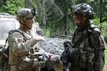U.S. Army Col. David Gardner briefs Polish army Maj. Gen. Rajmund T. Andrzejczak
