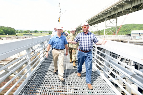 Cory Richardson (Right), lockmaster with the U.S. Army Corps of Engineers Nashville District, leads Vice Adm. Charles Ray, U.S. Coast Guard deputy commandant for Operations, on a tour of Chickamauga Lock May 4, 2018 at Tennessee River mile 471 in Chattanooga, Tenn. Ray is the incoming assistant commandant of the Coast Guard. (USACE Photo by Lee Roberts)