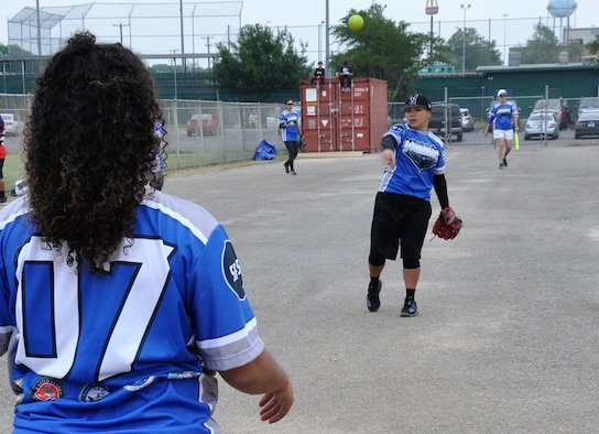 Tech. Sgt. Christina Rapolla, 433rd Training Squadron and JBSA-Lackland Warhawks women's softball team member, warms up before a game. (U.S. Air Force photo by Debbie Gildea)