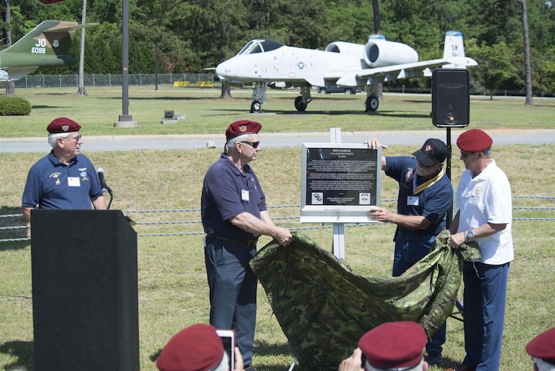 Members of the Society of the Vietnamese Airborne unveil a rededicated plaque for the O-2 Skymaster static display at Shaw Air Force Base, S.C., May 4, 2018.