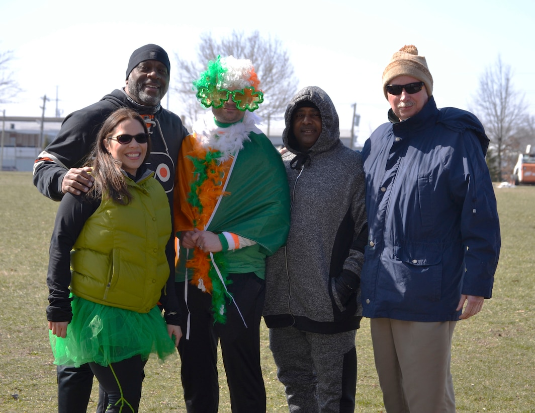 Members of DLA Troop Support Medical's operational customer facing division pose for a photo before a 5K run and walk for St. Patrick's Day at Naval Support Activity Philadelphia, March 15, 2018.