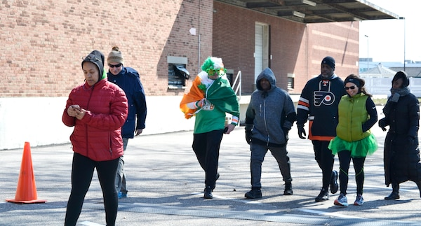 Members of DLA Troop Support Medical's operational customer facing division participate in a St. Patrick's Day 5K run and walk for St. Patrick's Day at Naval Support Activity Philadelphia, March 15, 2018.
