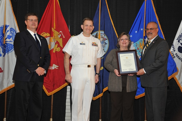 IMAGE: Kathy Clark is presented the Navy Meritorious Civilian Service Award at Naval Surface Warfare Center Dahlgren Division's annual awards ceremony, Apr. 26 at the Fredericksburg Expo and Conference Center.