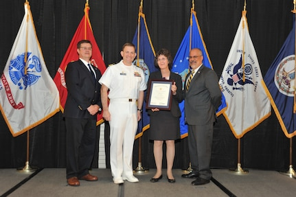 IMAGE: Leslie Madden is presented the Navy Meritorious Civilian Service Award at Naval Surface Warfare Center Dahlgren Division's annual awards ceremony, Apr. 26 at the Fredericksburg Expo and Conference Center.