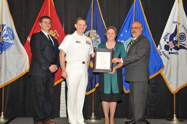 IMAGE: Jacqueline Cheramie is presented the Navy Meritorious Civilian Service Award at Naval Surface Warfare Center Dahlgren Division's annual awards ceremony, Apr. 26 at the Fredericksburg Expo and Conference Center.