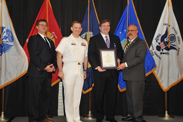 IMAGE: Jeff Allen is presented the Navy Meritorious Civilian Service Award at Naval Surface Warfare Center Dahlgren Division's annual awards ceremony, Apr. 26 at the Fredericksburg Expo and Conference Center