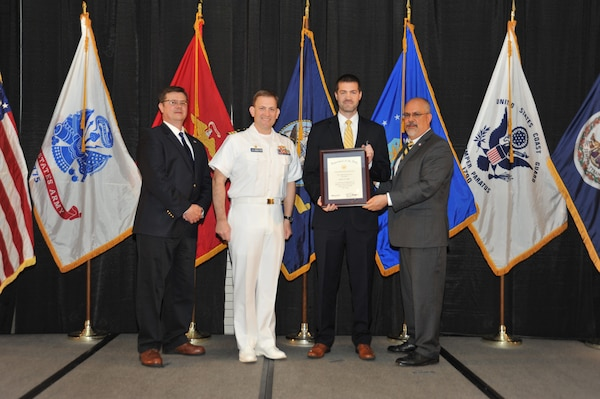 IMAGE: Robert Bills is presented the Navy Meritorious Civilian Service Award at Naval Surface Warfare Center Dahlgren Division's annual awards ceremony, Apr. 26 at the Fredericksburg Expo and Conference Center.