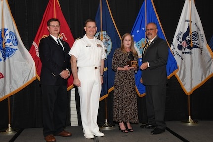 """IMAGE: Denise Bagnall is presented the John Adolphus Dahlgren Award at Naval Surface Warfare Center Dahlgren Division's annual awards ceremony, Apr. 26 at the Fredericksburg Expo and Conference Center.  The Dahlgren Award is named for Rear Adm. John A. Dahlgren – who is considered the """"Father of Modern Naval Ordnance"""" - and honors individuals with significant achievement in science, engineering or management."""