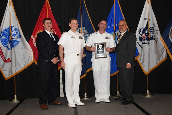 IMAGE: Master Chief Fire Controlman Nathaniel Melvin is presented the C.J. Rorie Award at Naval Surface Warfare Center Dahlgren Division's annual awards ceremony, Apr. 26 at the Fredericksburg Expo and Conference Center.