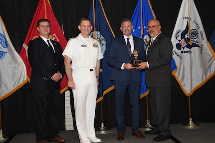 IMAGE: Patrick Freemyers is presented the Dr. James Colvard Award at Naval Surface Warfare Center Dahlgren Division's annual awards ceremony, Apr. 26 at the Fredericksburg Expo and Conference Center.