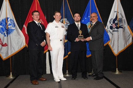 IMAGE: Jonathan Brown is presented the Dr. James Colvard Award at Naval Surface Warfare Center Dahlgren Division's annual awards ceremony, Apr. 26 at the Fredericksburg Expo and Conference Center.