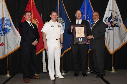 IMAGE: John Jims is presented the Bernard Smith Award at Naval Surface Warfare Center Dahlgren Division's annual awards ceremony, Apr. 26 at the Fredericksburg Expo and Conference Center.