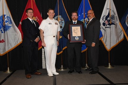 IMAGE:Christopher Behre is presented the Bernard Smith Award at Naval Surface Warfare Center Dahlgren Division's annual awards ceremony, Apr. 26 at the Fredericksburg Expo and Conference Center.