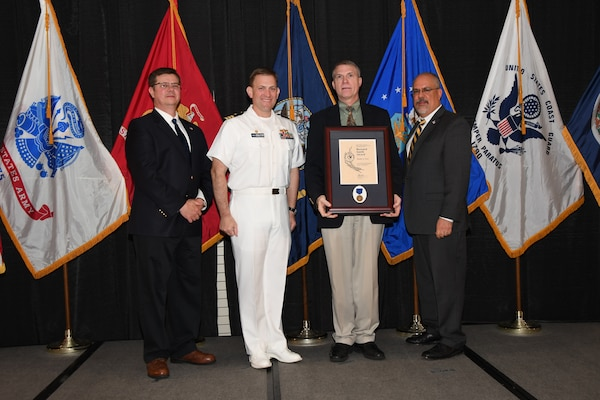 IMAGE: Bradley Flock is presented the Bernard Smith Award at Naval Surface Warfare Center Dahlgren Division's annual awards ceremony, Apr. 26 at the Fredericksburg Expo and Conference Center.