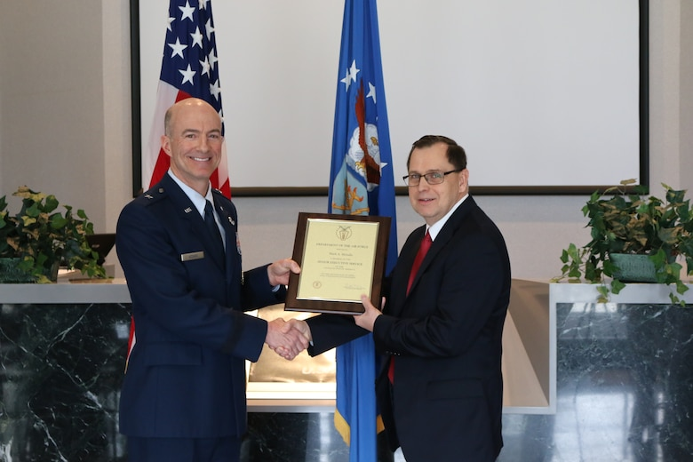 Dr. Mark Mehalic, right, receives a plaque commemorating his appointment to the Senior Executive Service from Brig. Gen. Christopher Azzano, director of Air, Space and Cyberspace Operations at Air Force Materiel Command, Wright-Patterson Air Force Base, Ohio. Mehalic, who previously served at Arnold Air Force Base as AEDC executive director and vice director, is now the deputy director of Air, Space and Cyberspace Operations at AFMC. (U.S. Air Force photo/Bradley Hicks)