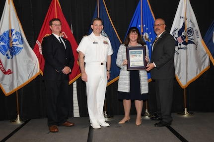 IMAGE: Cheryl Subacius is presented the Helen Springer Award at Naval Surface Warfare Center Dahlgren Division's annual awards ceremony, Apr. 26 at the Fredericksburg Expo and Conference Center.