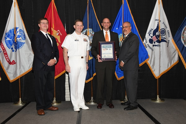 IMAGE: Michael Shively is presented the Helen Springer Award at Naval Surface Warfare Center Dahlgren Division's annual awards ceremony, Apr. 26 at the Fredericksburg Expo and Conference Center.