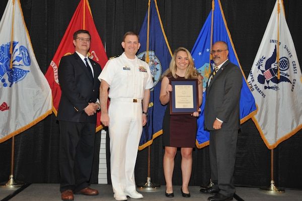 IMAGE: Courtney Sloat is presented the Leadership Award at Naval Surface Warfare Center Dahlgren Division's annual awards ceremony, Apr. 26 at the Fredericksburg Expo and Conference Center.