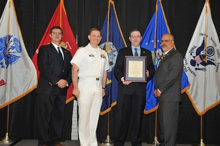 IMAGE: Daniel Dunn is presented the Leadership Award at Naval Surface Warfare Center Dahlgren Division's annual awards ceremony, Apr. 26 at the Fredericksburg Expo and Conference Center.