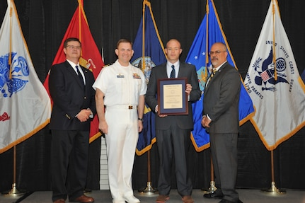 IMAGE: Parker Page is presented the Leadership Award at Naval Surface Warfare Center Dahlgren Division's annual awards ceremony, Apr. 26 at the Fredericksburg Expo and Conference Center.
