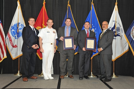 IMAGE: Edwin Regan and Todd Graves are presented the Leadership Award at Naval Surface Warfare Center Dahlgren Division's annual awards ceremony, Apr. 26 at the Fredericksburg Expo and Conference Center.