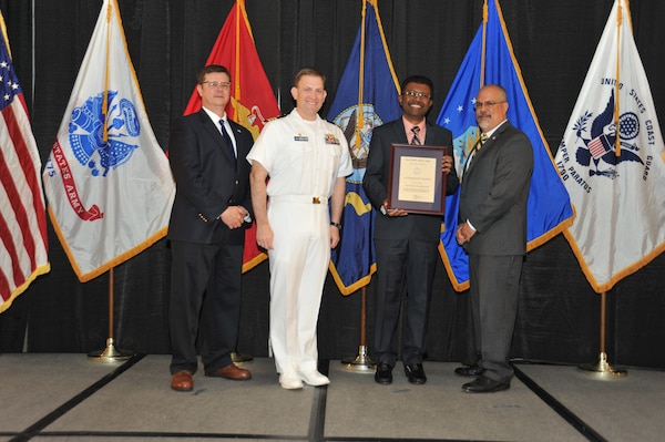 IMAGE: Gunendran Sivapragasam  is presented the Leadership Award at Naval Surface Warfare Center Dahlgren Division's annual awards ceremony, Apr. 26 at the Fredericksburg Expo and Conference Center.