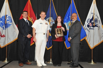IMAGE:Kim Thorton is presented the Employee Development Award at Naval Surface Warfare Center Dahlgren Division's annual awards ceremony, Apr. 26 at the Fredericksburg Expo and Conference Center.