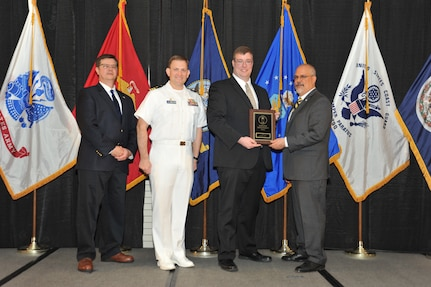 IMAGE: Kevin Cogley is presented the Employee Development Award at Naval Surface Warfare Center Dahlgren Division's annual awards ceremony, Apr. 26 at the Fredericksburg Expo and Conference Center.