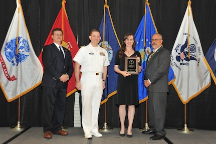 IMAGE: Allison Mead is presented the Employee Development Award at Naval Surface Warfare Center Dahlgren Division's annual awards ceremony, Apr. 26 at the Fredericksburg Expo and Conference Center.