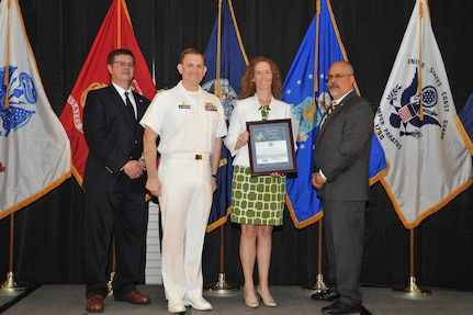 IMAGE: Debbie Bardine is presented the Commander's Diversity and Inclusion Award at Naval Surface Warfare Center Dahlgren Division's annual awards ceremony, Apr. 26 at the Fredericksburg Expo and Conference Center.