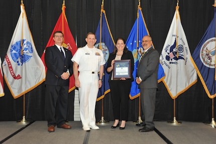 IMAGE: Shellie Clift is presented the Commander's Diversity and Inclusion Award at Naval Surface Warfare Center Dahlgren Division's annual awards ceremony, Apr. 26 at the Fredericksburg Expo and Conference Center.