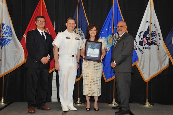 IMAGE: Kathryn Dawson is presented the Commander's Diversity and Inclusion Award at Naval Surface Warfare Center Dahlgren Division's annual awards ceremony, Apr. 26 at the Fredericksburg Expo and Conference Center.