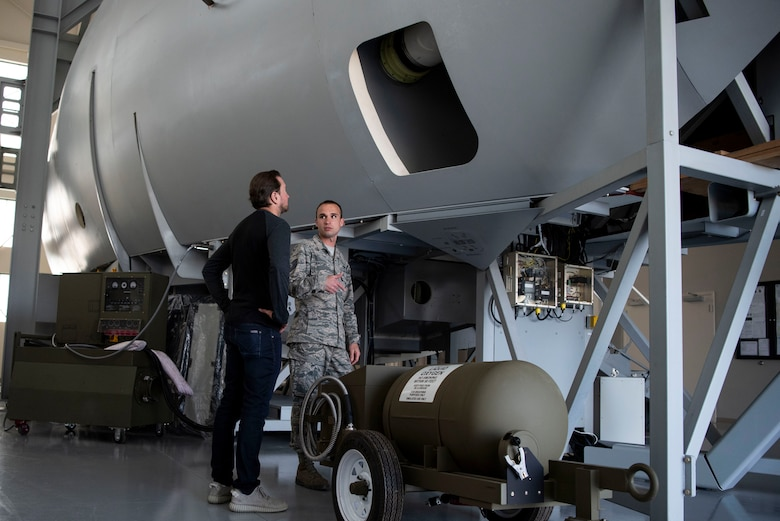Tech. Sgt. Ross Krotzer, 373rd Training Squadron Detachment 3 C-17 Environmental and Electrical instructor, talks to Kurt Busch, driver of the No. 41 Stewart-Haas Racing Ford Fusion car, during a tour of the 373rd TS Det. 3 May 3, 2018, at Dover Air Force Base, Del. Busch and Krotzer discussed the similarities and differences between racing and flying. (U.S. Air Force photo by Airman 1st Class Zoe M. Wockenfuss)